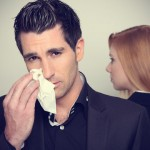 man-wipes-his-nose-with-a-tissue