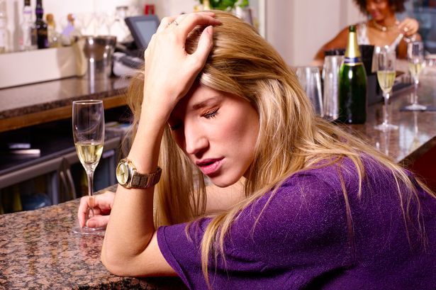 Depressed female drunk in Bar